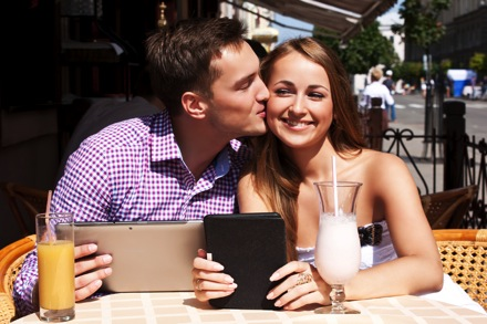 Young affluent couple at cafe