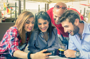 What the Big Shift to Mobile Means for Your Business: Group of folks using mobile to find the answers to her questions