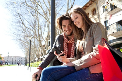 Your Big Opportunity When The Current Crisis Ends? Adults Under 40: Young couple reading on mobile phone