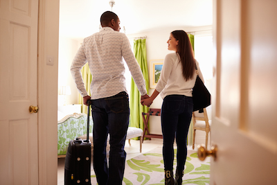 8 Excellent Answers to the Question, How Important is Technology to Hospitality Marketing? Hospitality Marketing Link Digest: Couple entering room