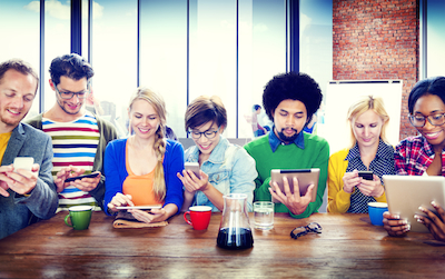 For Marketers, It's Not a Mobile Phone. It's a Window: Customers looking at mobile devices