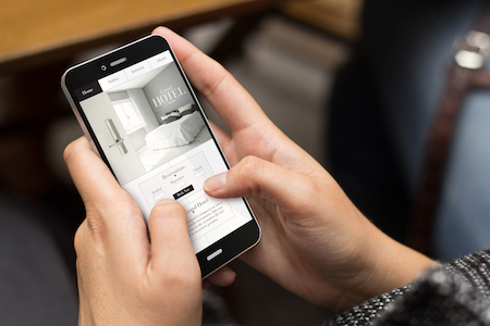 Guest using mobile phone to book, one of 2019's hotel marketing tech trends