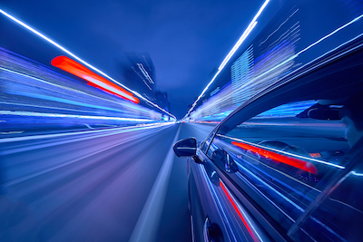 Speed: The single biggest change to business - fast-moving car driving towards the future